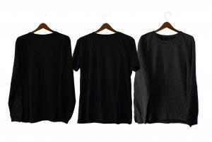 three dark t-shirts on hangers